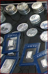 silver_coins_bars_on_shelf